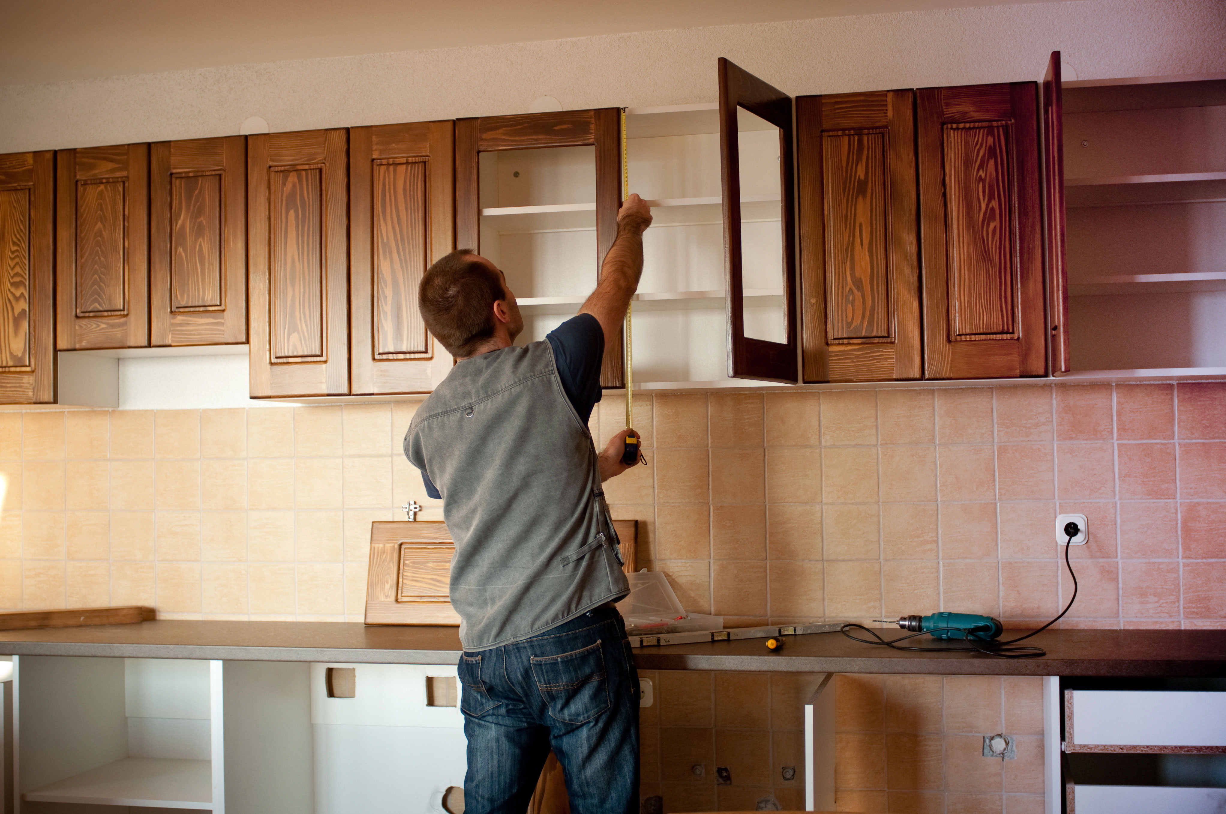 Photo of a man remodeling a kitchen