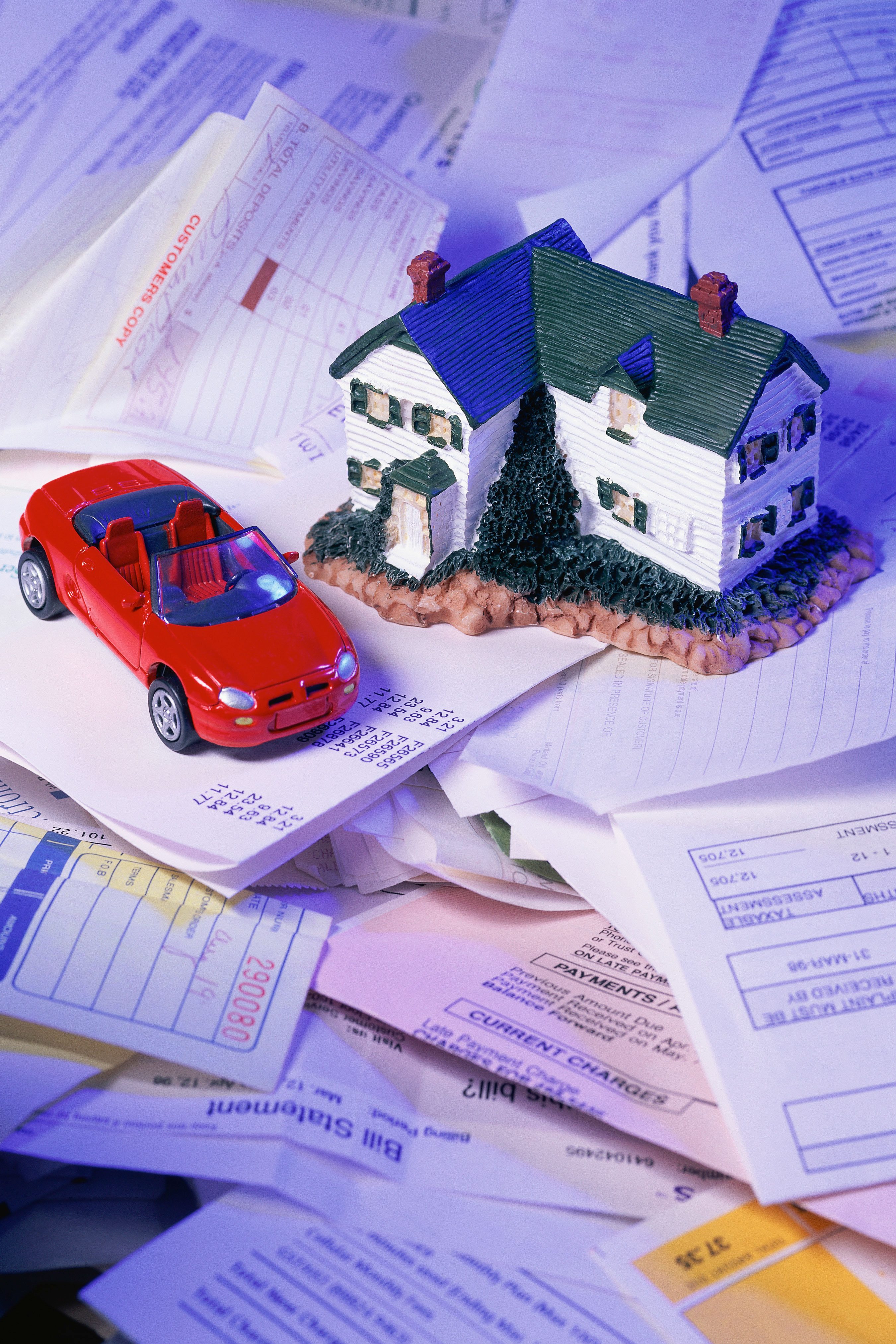 Photo of a house and paperwork