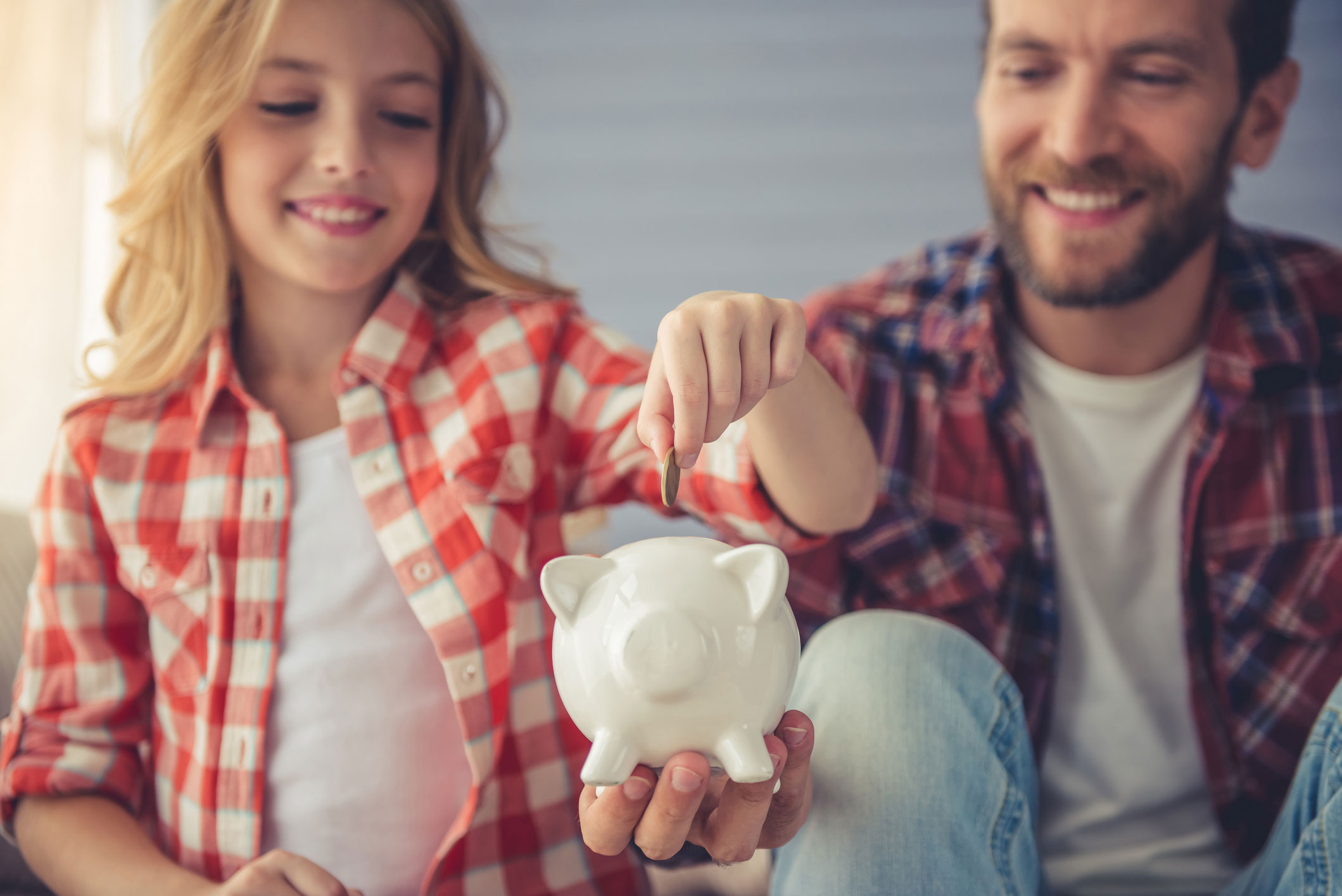 Photo of child and piggy bank