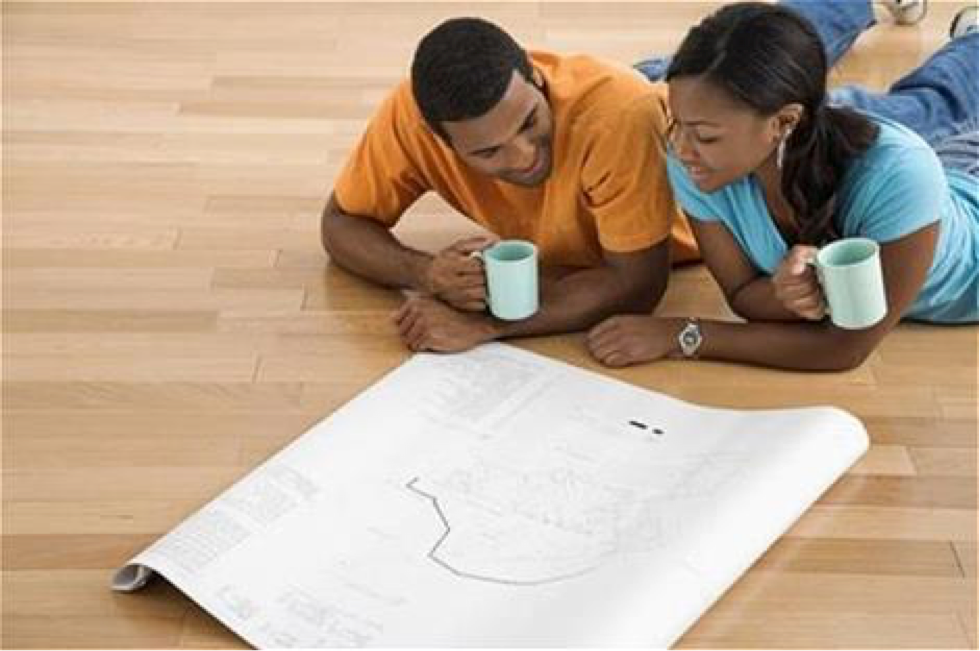 Photo of a couple looking at housing plans
